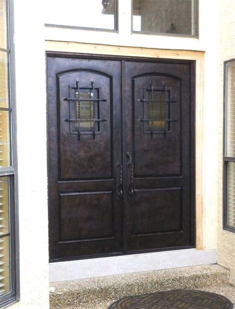 wrought iron  panel speakeasy double door rustic