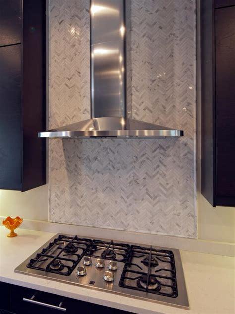 herringbone tile backsplash  stainless range hood hgtv