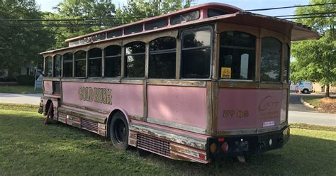 Why is there an old trolley on Airport Road in Greenville?