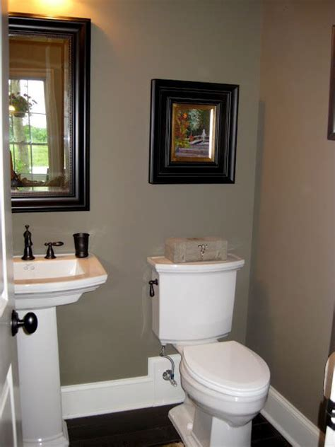 hall bath idea tan walls white trim bronze accents simple bathroom decor small bathroom