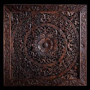 Hand carved wall panel made from teak wood hanging