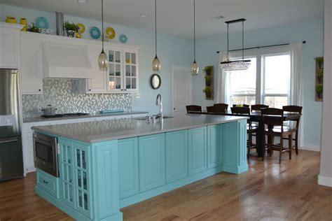 white kitchen cabinets  teal island grey quartz