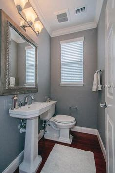 traditional powder room  built  bookshelf white