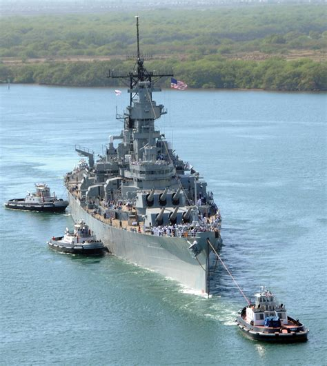 Uss Missouri (bb-63) With Her Flock Of Tugs Returning To