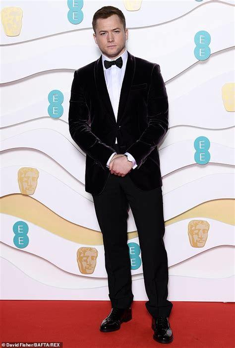 BAFTAs 2020: Taron Egerton and Emily Thomas on red carpet ...