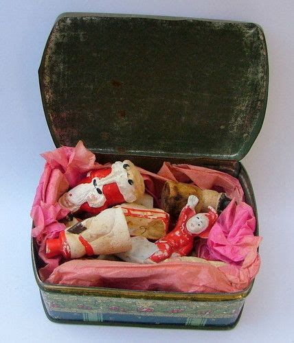 christmas cake decorations in old toffee tin vintage