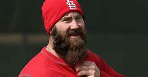relief pitcher Jason Motte talks on the field with his ...