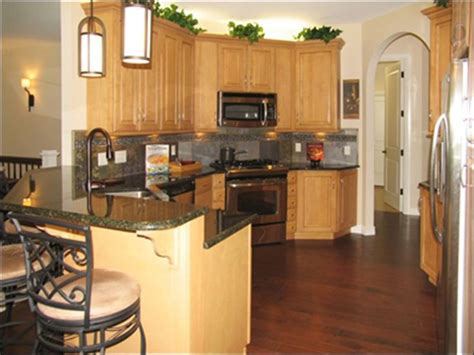 what color wood floor goes with oak cabinets honey oak cabinets with dark hardwood floor birch