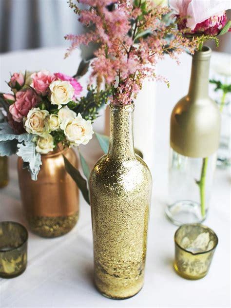 empty glass bottles fill   gorgeous wedding centerpieces