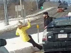 Man seen shoving woman to the ground in alleged road rage ...