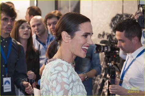 Emma Watson Sweeps Her Hair Aside For Noah Premiere
