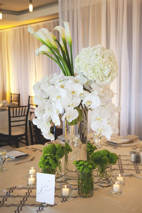 table centrepieces ideas white hydrangea orchid and calla centerpiece