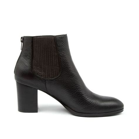 Featuring a square toe they are made from brown suede with smooth brown leather used as a feature on the front and sides of the shoe. Diana Ferrari DEIGHT Boots Black • And & The Store