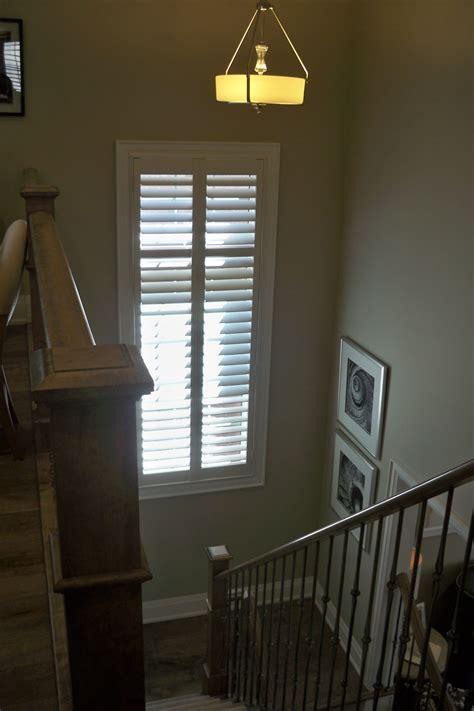 tall window  stairwell  classic white custom window