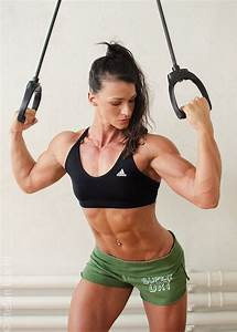 Personal Trainer Cindy Landolt flexing her biceps and abs ...