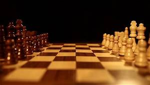 Side Shot Of A Chess Board Over A Black Background And The