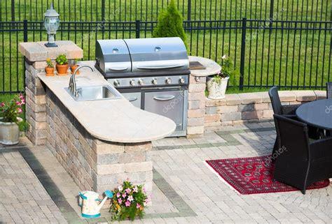 stylish outdoor kitchen   brick patio stock photo