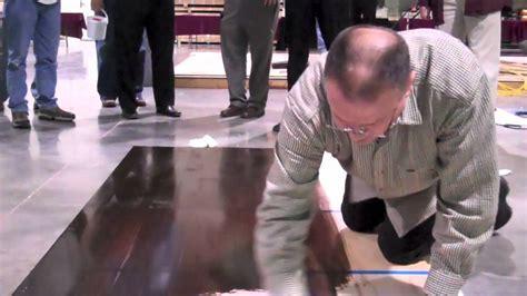 Applying Rust Oleum's Nano Shield Stain on wood flooring w