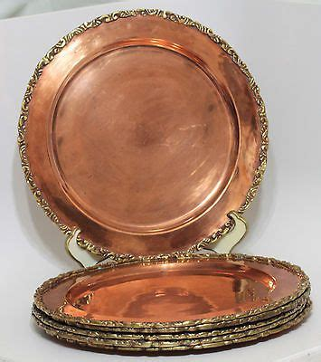set   vintage solid copper charger plates applied brass edge  hand  copper charger