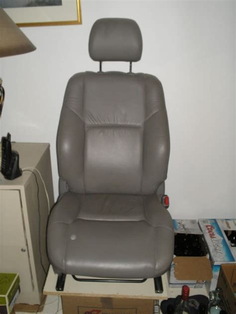replacing 04 tacoma cloth seat with 04 4runner leather