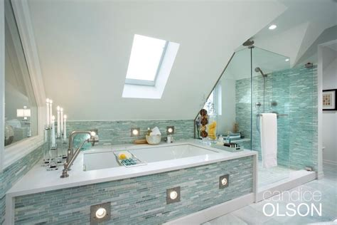 a soaker tub with a broad white quartz deck invites