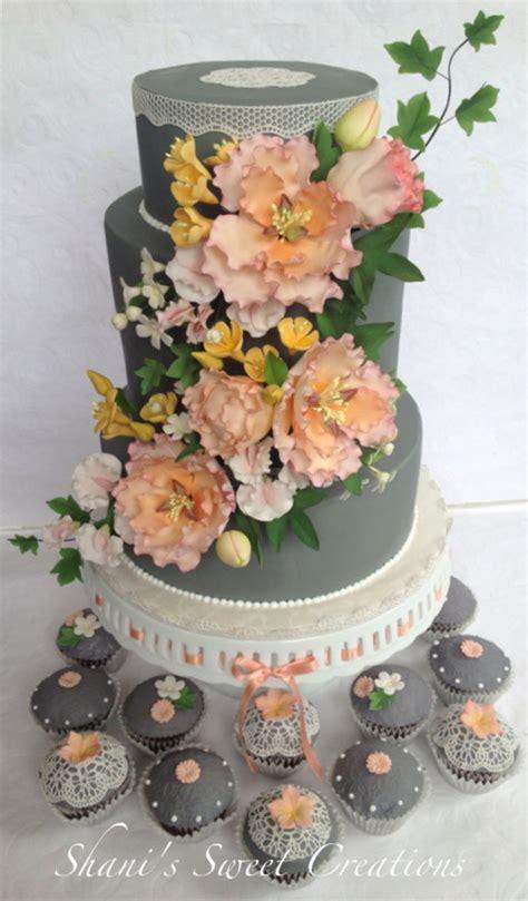 wedding cake  matching cupcakes  sugar flowers