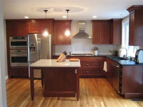 walnut color cabinets black granite white subway tiles