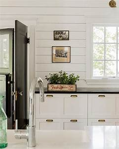 white cottage kitchen black accents design ideas With best brand of paint for kitchen cabinets with vintage subway sign wall art