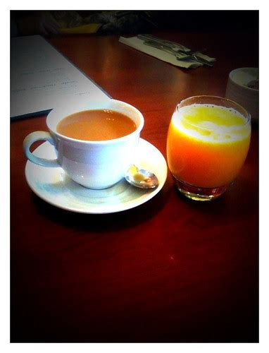 A portentous event, report, or situation that brings an issue to immediate attention. Wake up call coffee and juice... | ian giovanni | Flickr