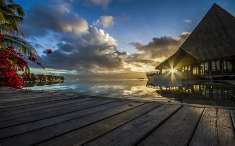 sunset tahiti french polynesia resort sea tropical