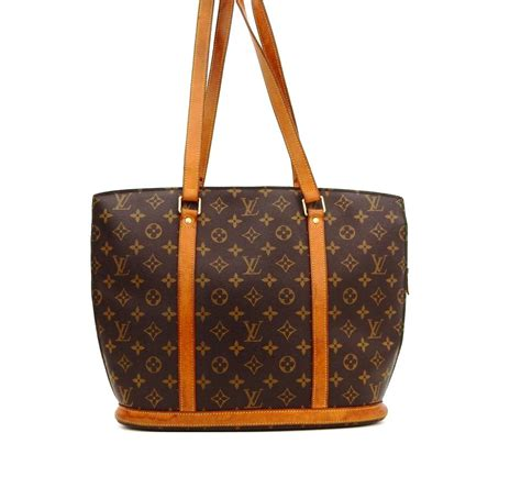 louis vuitton babylone carry  bown monogram canvas leather shoulder bag tradesy
