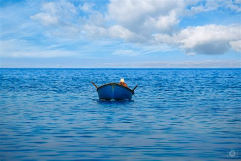 small sea fisherman in small boat in the sea background high quality free backgrounds