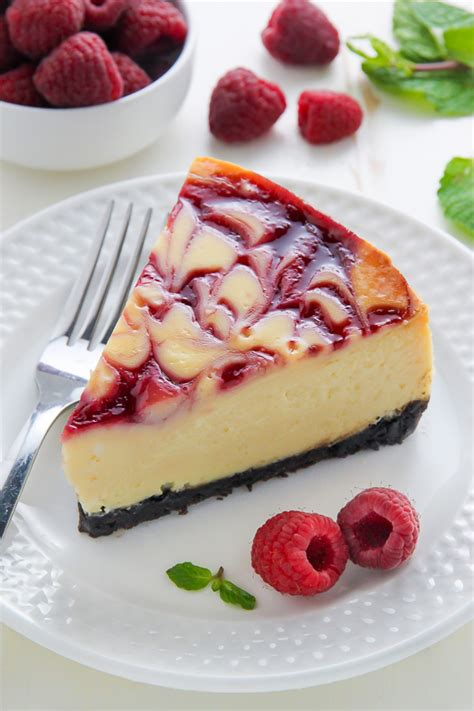 Raspberry sauce is swirled into the batter of a creamy white chocolate cheesecake. White Chocolate Raspberry Cheesecake - Baker by Nature