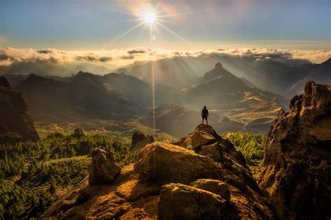 nature panorama summit man sun highlight rock hd wallpaper