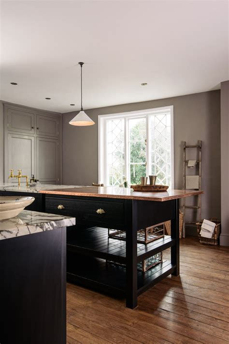 Stylish Cupboards by Stylish Black Shaker Cupboards Paired With An