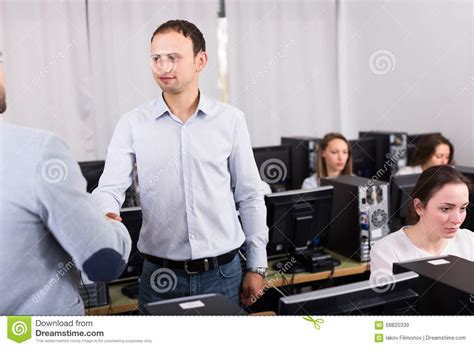Manager Shaking Hand Of Employee Stock Photo