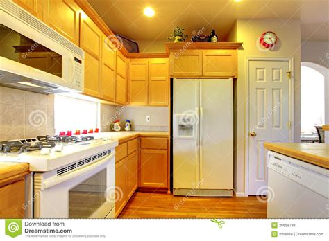 kitchen  yellow wood cabinets royalty  stock