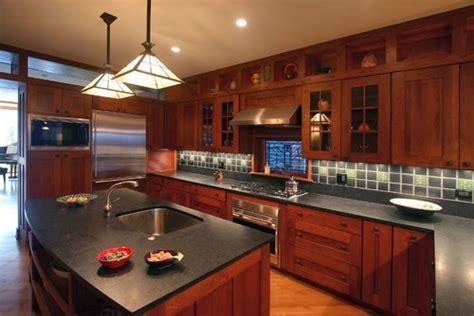 honed black granite counters  shaker style cherry