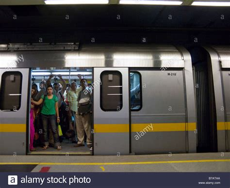 metro open doors a yellow line carriage with open doors at a