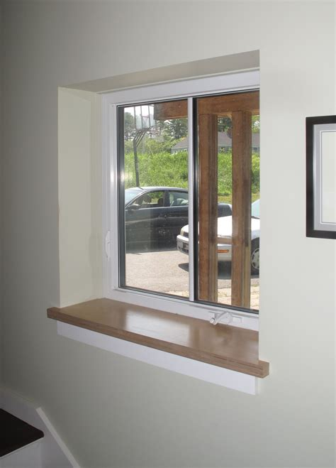 White Window Ledge by Drywall Return At Jambs And Header With Wood Sill By