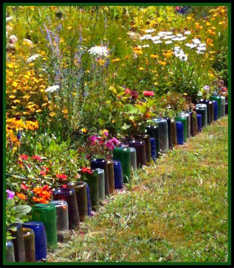 upcycle glass bottles into a garden border green