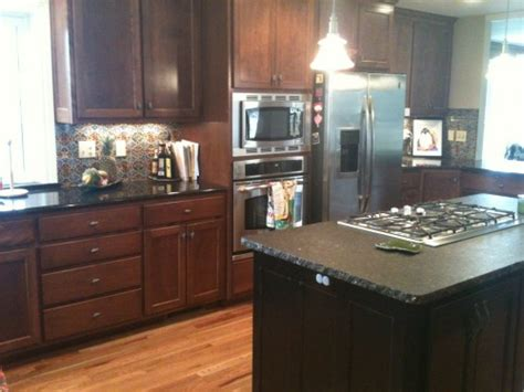 how can i brighten up my kitchen my kitchen has black granite counter tops and stained