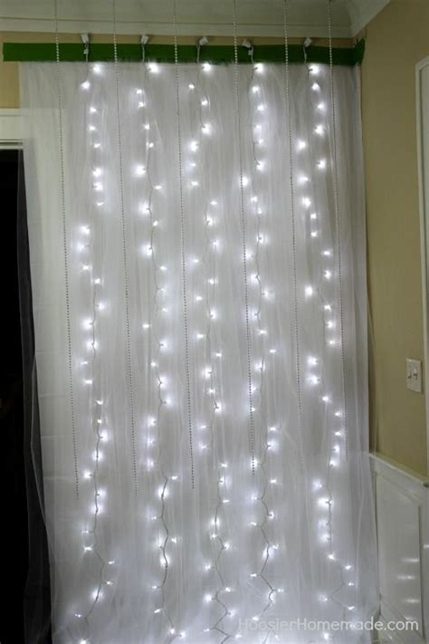 easy diy photo booth photo booth backdrop string lights