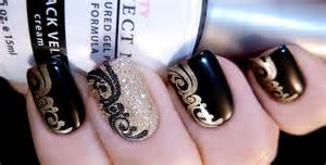Black and gold stamped nail art by tenlittlecanvases on