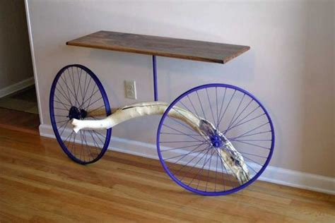 hand crafted entry table   bike wheels tree
