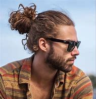 Curly Hair Man Bun Hairstyle