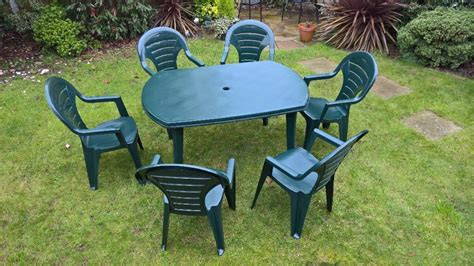 Lawn Table And Chairs by Garden Table Chairs And Parasol Set Green Plastic In
