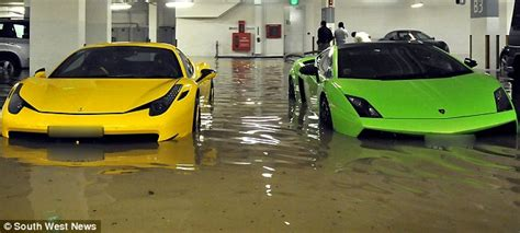 supercars costing millions wrecked  flash flood  singapore