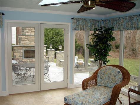 season sunroom  bluestone patio  fireplace