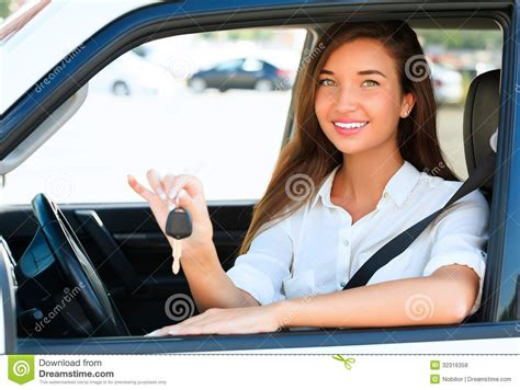 Girl Showing The Car Key Royalty Free Stock Photos